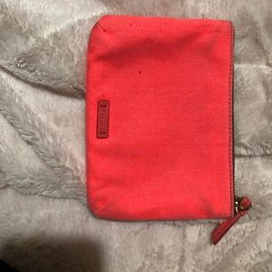 Coral colored fossil zip pouch
